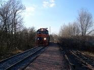 train-approaching-bridge